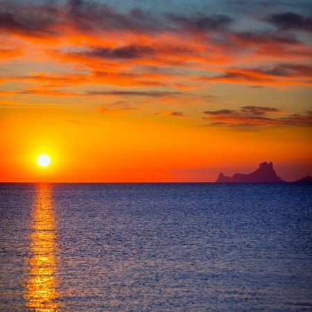 vedra: Ibiza sunset Es Vedra view from Formentera la Savina red orange sky