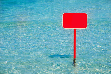 sign blank: turquoise tropical sea with red sign blank copyspace Stock Photo