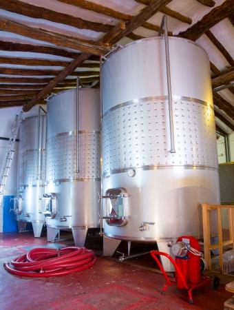 fermenting: Stainless steel fermentation tanks vessels indoor of mediterranean winery