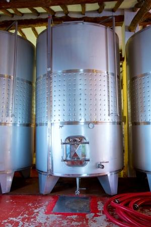 vats: Stainless steel fermentation tanks vessels indoor of mediterranean winery
