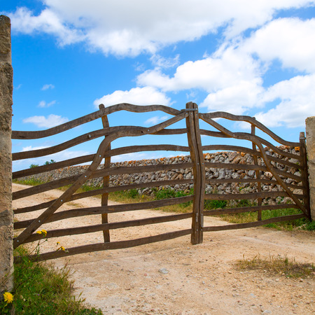 Menorca traditional wooden fence gate in Balearic islands photo