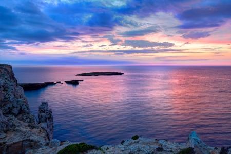 es: Menorca sunset in Cap de Caballeria cape at Balearic Islands es Mercadal