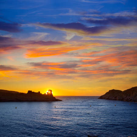 Menorca sunset in Cala Morell at Ses torretes beach Balearic Islands photo