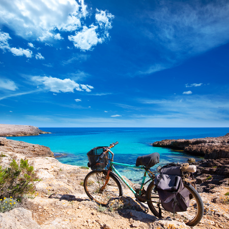 Menorca Cala des Talaier beach with aged grunge bicycle photo