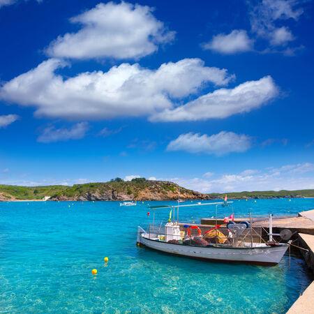 es: Menorca Es Grau clean port with llaut boats in Balearic Islands Stock Photo