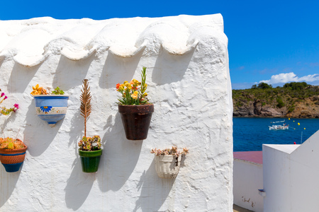 es: Menorca Es Grau white house flower pots detail in Balearic Islands Stock Photo