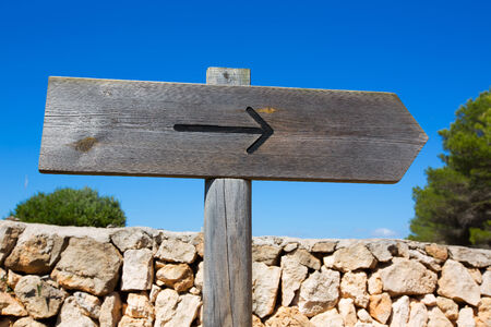 blank road sign: Arrow wooden track blank road sign in Mediterranean Balearic islands