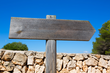 road surface: Wooden track blank road sign in Mediterranean Balearic islands