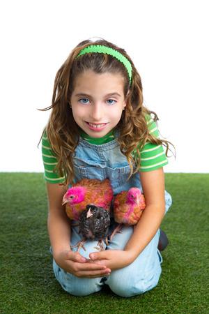 rancher: breeder hens kid girl rancher farmer hug chicken chick white background Stock Photo