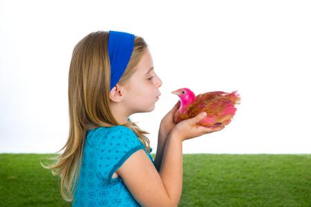 rancher: breeder hens kid girl rancher farmer kissing a chicken chick white background Stock Photo
