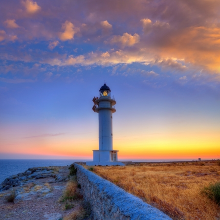 formentera: Formentera sunset in Barbaria cape lighthouse at Balearic Mediterranean islands Stock Photo