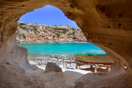 Formentera Cala en Baster in Balearic Islands of Spain from the cave indoor Фото со стока