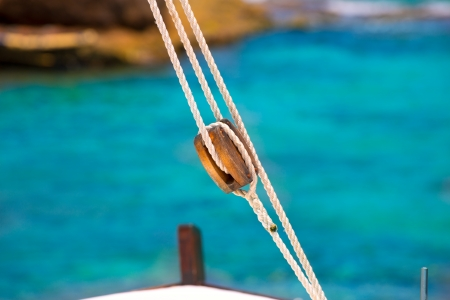 rigging: Boat classic pulley from sailboat in Mediterranean at Balearic Islands Stock Photo