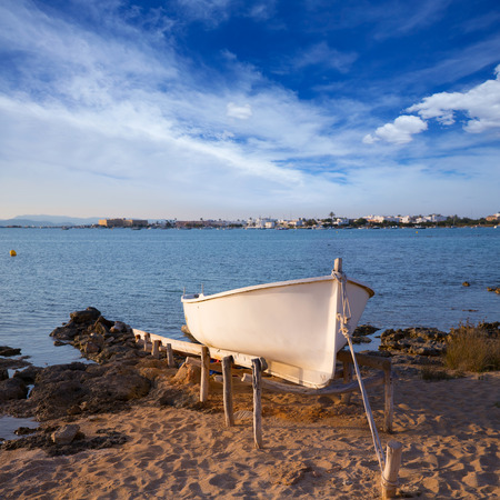 Beached boat in Estany des Peix at Formentera Balearic Islands of Spain photo