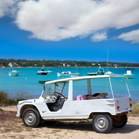formentera: Formentera Estany des Peix with white convertible retro near Ibiza