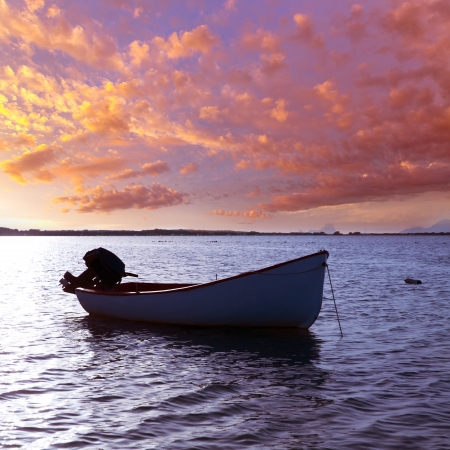 Boat sunset  Estany des Peix in Formentera Balearic Islands of Spain photo