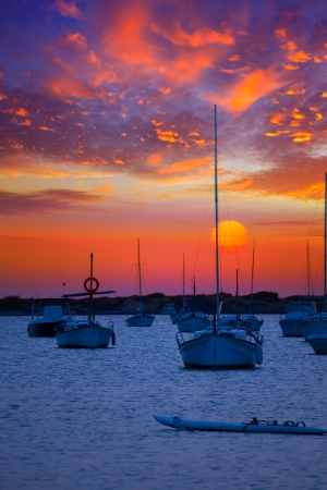 Formentera sunset at Estany des Peix lake in Balearic Islands photo