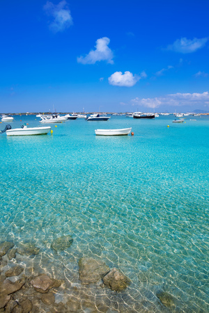 Formentera boats at Estany des Peix lake in Balearic Islands photo