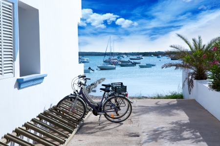 Estany des Peix in formentera with bicycles parking lot and white Mediterranean houses photo