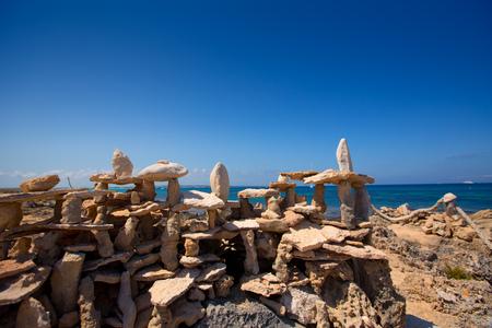 formentera: Stone figures on beach shore of Illetes beach in Formentera Mediterranean Balearic Islands