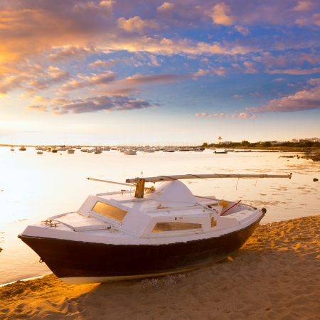 Beached sailboat sunset  Estany des Peix in Formentera Balearic Islands of Spain photo