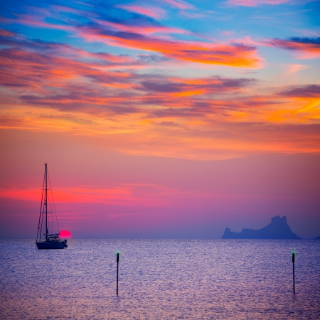 formentera: Ibiza sunset sun view from formentera Island with sailboat in Balearic Islands Stock Photo