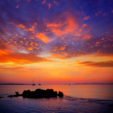 Ibiza sunset view from formentera Island with sailboat in Balearic Islands Stock fotó