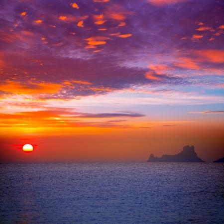 Ibiza sunset view from formentera Island in Balearic Islands photo
