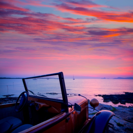 ibiza: Ibiza sunset view from vintage car at formentera Island in Balearic Islands Stock Photo