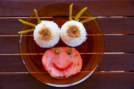 nouse: Funny kid food with rice and meat with a smiley face