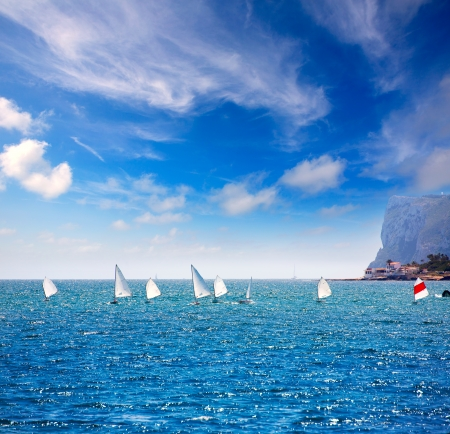alicante: Little sailboats Optimist learning to sail in Mediterranean at Denia Alicante