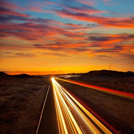 arizona landscape: Arizona sunset at Freeway 40 with cars light traces USA Stock Photo
