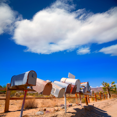 Grunge mail boxes in a row at California Mohave desert USA photo