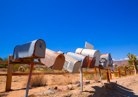 mohave: Grunge mail boxes in a row at California Mohave desert USA Stock Photo
