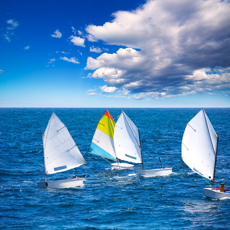 yacht race: Little sailboats Optimist learning to sail in Mediterranean at Denia Alicante