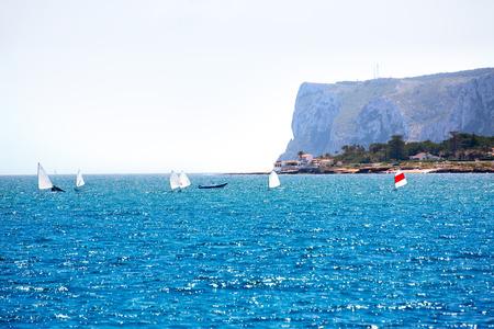 optimist: Little sailboats Optimist learning to sail in Mediterranean at Denia Alicante