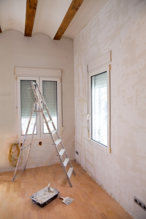 reform: House indoor improvements plater tools and ladder in real situation