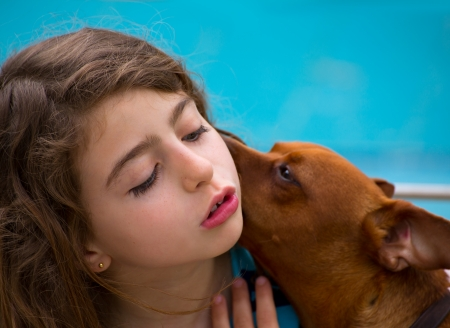 dido: Brunette kid girl and dog pet mascot whispering ear Stock Photo