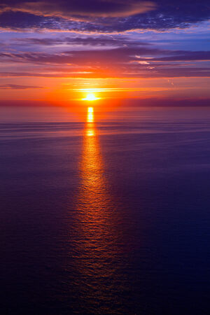 sunset sunrise over blue Mediterranean sea photo
