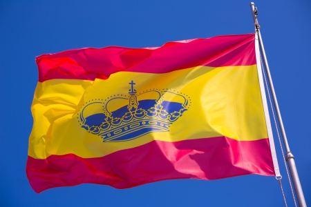 flaw: Spain red and yellow flaw waving on wind under blue sky