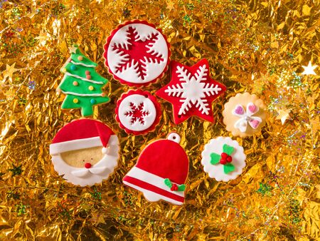 Christmas cookies Xmas tree Santa snowflake on golden background photo