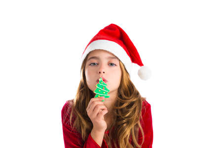 Christmas kid girl kissing Xmas tree cookie isolated on white background Stock Photo - 24383147