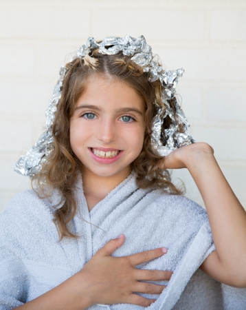 dido: Funny kid girl smiling with his dye hair with foil blue eyes