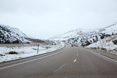 interstate: US snowing I 15 interstate snowed road in Nevada USA Stock Photo