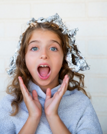 dido: Funny kid girl surprised with his dye hair with foil blue eyes