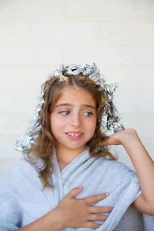 dido: Funny kid girl scared about his dye hair with foil blue eyes Stock Photo