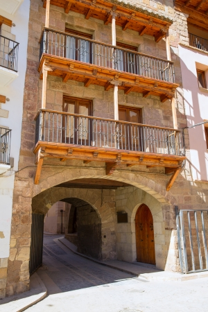 rock arch: Mora de Rubielos masonry arches in Teruel Aragon stonewall village Maestrazgo Spain Stock Photo
