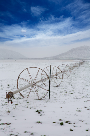 Cereal fields with irrigation wheels with snow in Nevada USA Stock Photo - 24581788