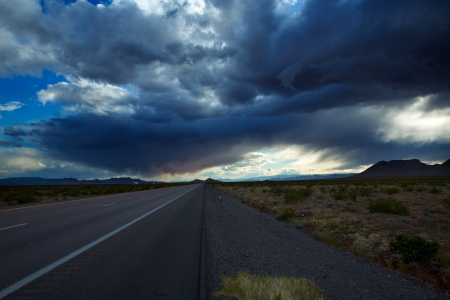 storm background: Stormy clouds dramatic clouds sky in I-15 interestate at Nevada USA