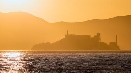 penitentiary: Alcatraz island penitentiary at sunset backlight in san Francisco California USA